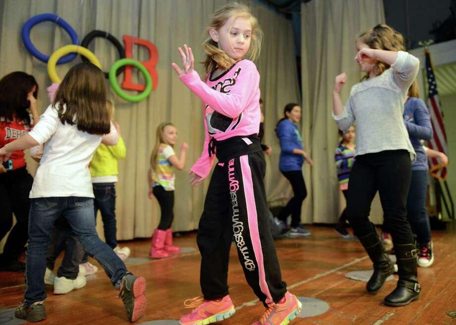"""The Olympics"" Fun Fair in the gym at Bradley School in Derby, Conn. Saturday, Feb. 22, 2014. Photo: Autumn Driscoll / Connecticut Post"