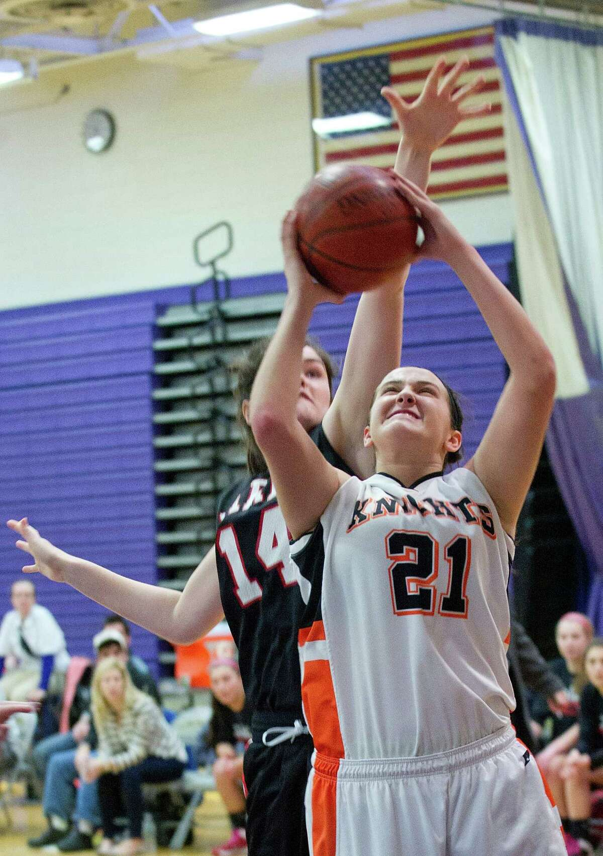 Stamford's Kelsey Santagata puts up a shot during Saturday's FCIAC girls basketball quarterfinal game against Fairfield Warde at Westhill High School on February 22, 2014.