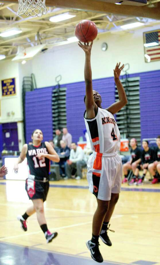 Stamford's Camry Evans puts up a shot during Saturday's FCIAC girls basketball quarterfinal game against Fairfield Warde at Westhill High School on February 22, 2014. Photo: Lindsay Perry / Stamford Advocate