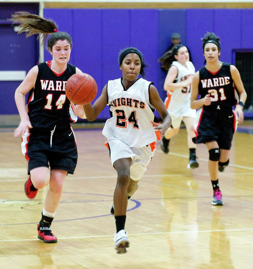 Stamford's Tiana England controls the ball during Saturday's FCIAC girls basketball quarterfinal game against Fairfield Warde at Westhill High School on February 22, 2014. Photo: Lindsay Perry / Stamford Advocate