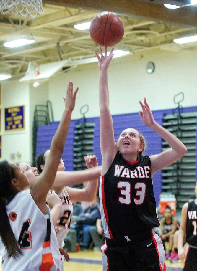 Fairfield Warde's Mary Kate McTague puts up a shot during Saturday's FCIAC girls basketball quarterfinal game against Stamford High School at Westhill High School on February 22, 2014. Photo: Lindsay Perry / Stamford Advocate
