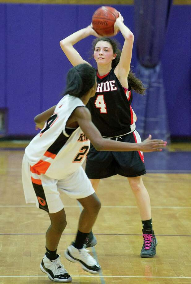 Fairfield Warde's Lejla Markovic passes the ball during Saturday's FCIAC girls basketball quarterfinal game against Stamford High School at Westhill High School on February 22, 2014. Photo: Lindsay Perry / Stamford Advocate