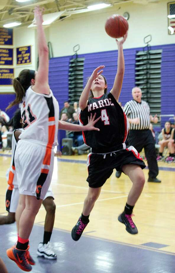 Fairfield Warde's Lejla Markovic puts up a shot during Saturday's FCIAC girls basketball quarterfinal game against Stamford High School at Westhill High School on February 22, 2014. Photo: Lindsay Perry / Stamford Advocate
