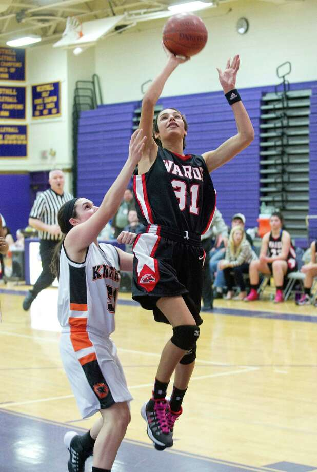 Fairfield Warde's Sarah Cotto puts up a shot during Saturday's FCIAC girls basketball quarterfinal game against Stamford High School at Westhill High School on February 22, 2014. Photo: Lindsay Perry / Stamford Advocate