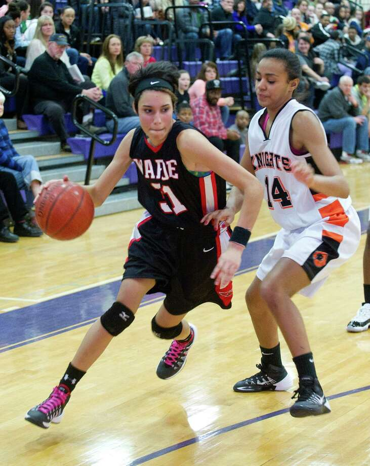 Fairfield Warde's Sarah Cotto controls the ball during Saturday's FCIAC girls basketball quarterfinal game against Stamford High School at Westhill High School on February 22, 2014. Photo: Lindsay Perry / Stamford Advocate