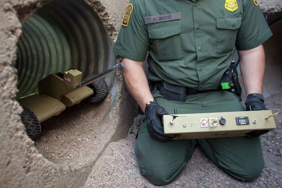 Kevin Hecht, a deputy patrol agent, demonstrates a robot in Nogales, Ariz. Robot surveillance on the border is becoming a valued asset to detect signs of suspicious activity in tunnels often used for drug smuggling. Photo: SAMANTHA SAIS, STR / NYTNS