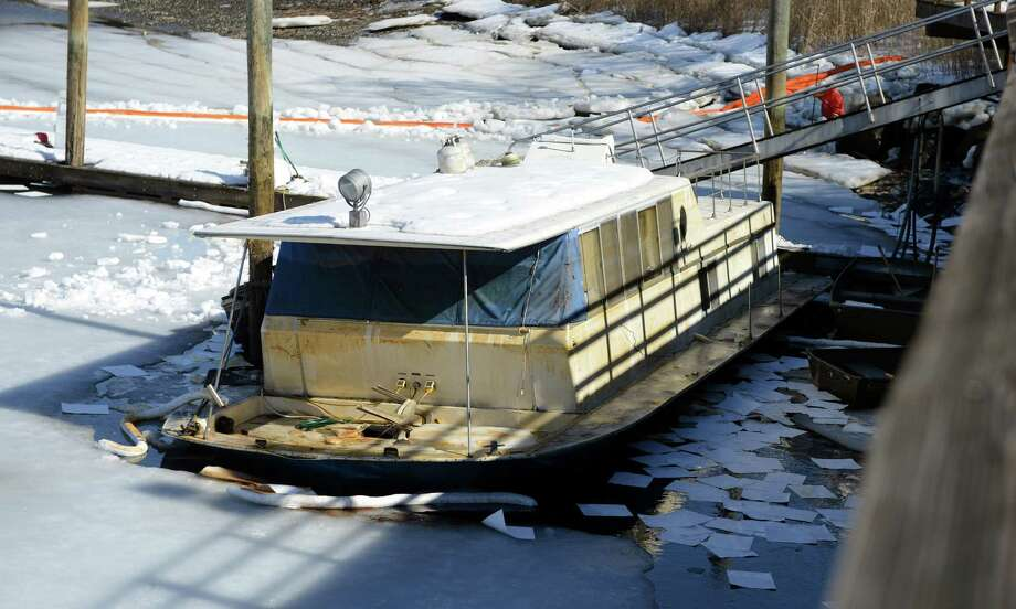 A Chris Craft houseboat leaks gasoline into the Norwalk River Saturday, Feb. 22, 2014, at Oyster Bend Marina in Norwalk, Conn. Photo: Autumn Driscoll / Connecticut Post