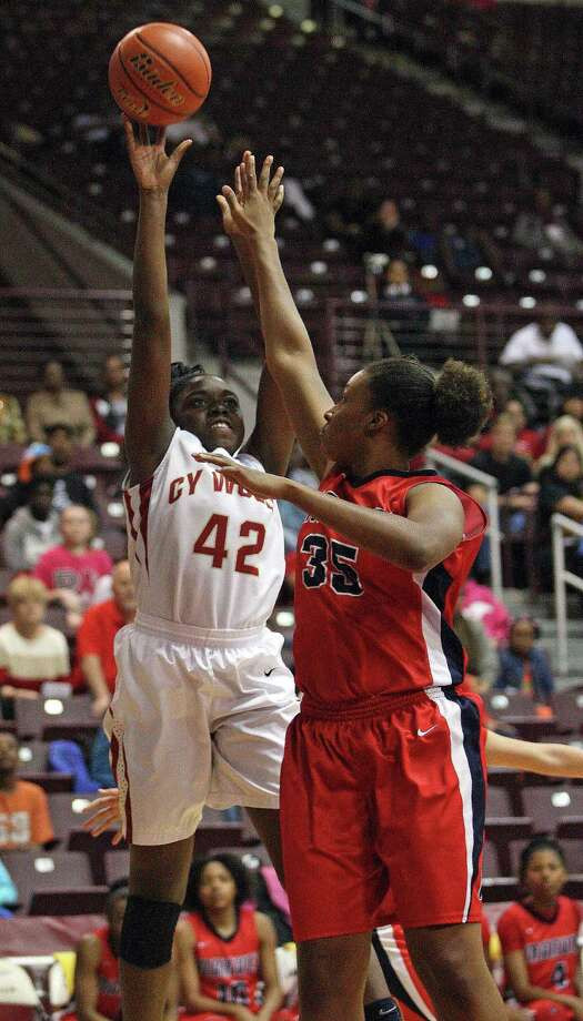Cy-Woods' Olivia Ogwumike (42) shoots over Manvel's Rangie Bessard during the first half of the Class 5A Region 3 Final girls high school basketball game, Saturday, February 22, 2014, at Campbell Center in Houston. Photo: Eric Christian Smith, For The Chronicle