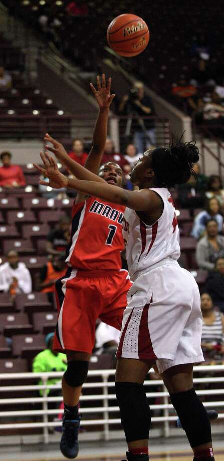 Manvel's Keyerra Fisher, left, shoots over Cy-Woods' Erica Ogwumike during the first half of the Class 5A Region 3 Final girls high school basketball game, Saturday, February 22, 2014, at Campbell Center in Houston. Photo: Eric Christian Smith, For The Chronicle