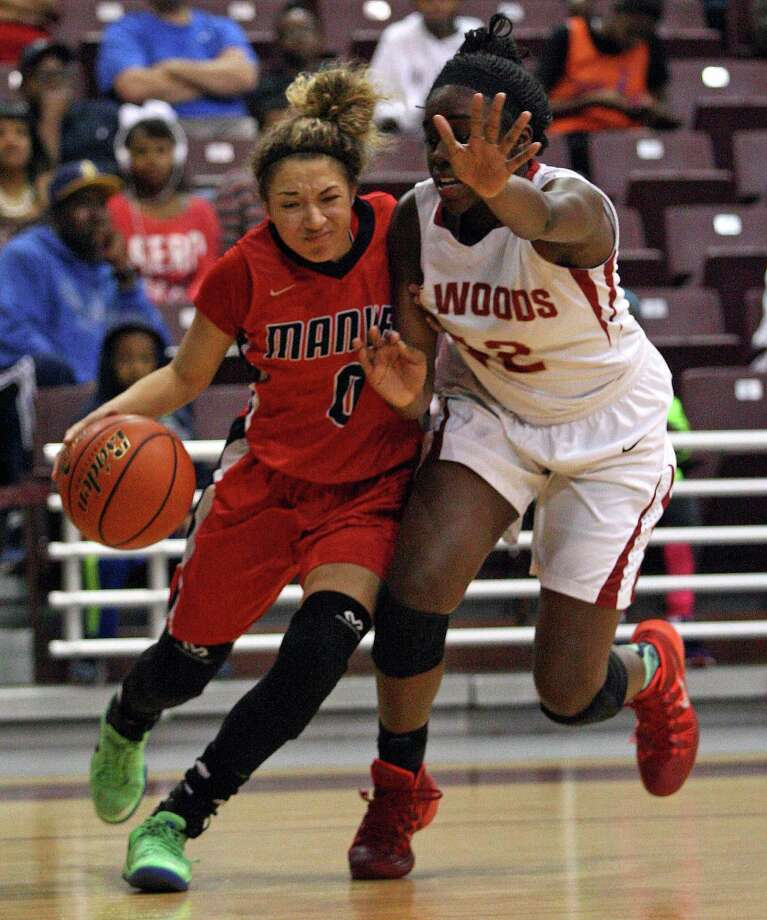 Manvel's Amieya Jackson, left, drives by Cy-Woods' Olivia Ogwumike during the first half of the Class 5A Region 3 Final girls high school basketball game, Saturday, February 22, 2014, at Campbell Center in Houston. Photo: Eric Christian Smith, For The Chronicle