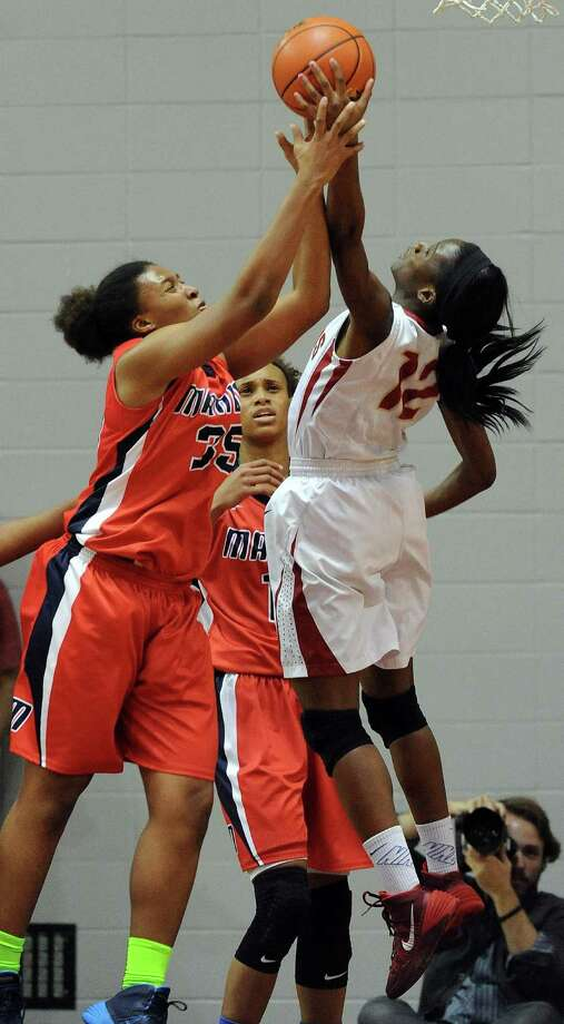 Manvel's Rangie Bessard, left, fights for a rebound with Cy-Woods' Gbemi Orundami during the first half of the Class 5A Region 3 Final girls high school basketball game, Saturday, February 22, 2014, at Campbell Center in Houston. Photo: Eric Christian Smith, For The Chronicle