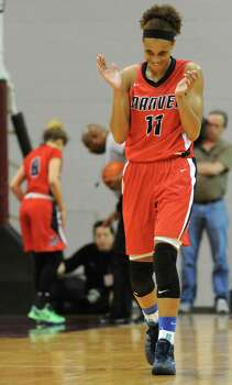 Manvel's Brianna Turner celebrates a Cy-Woods turnover during the first half of the Class 5A Region 3 Final girls high school basketball game, Saturday, February 22, 2014, at Campbell Center in Houston. Photo: Eric Christian Smith, For The Chronicle