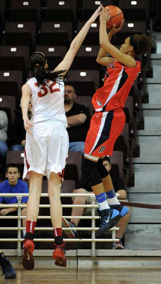 Cy-Woods' Nancy Mulkey, left, blocks the shot of Manvel's Brianna Turner during the first half of the Class 5A Region 3 Final girls high school basketball game, Saturday, February 22, 2014, at Campbell Center in Houston. Photo: Eric Christian Smith, For The Chronicle