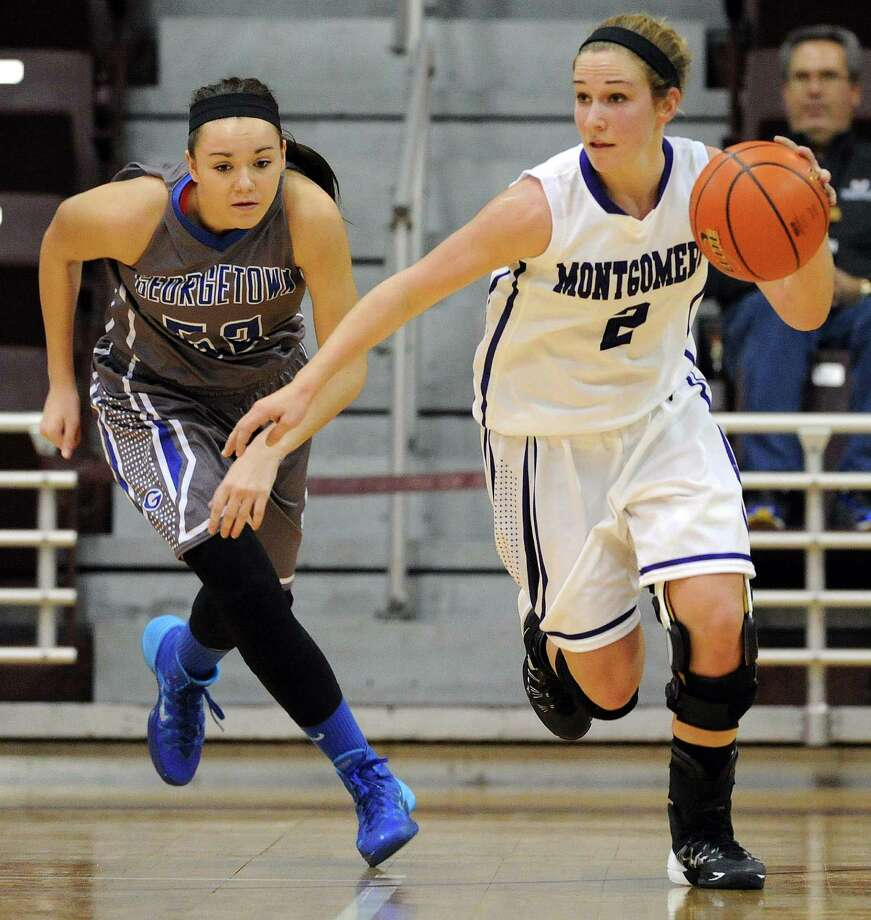 Montgomery's Malloree Schurr, right, dribbles past Georgetown's Maddie Anderson during the first half of the Class 4A Region 3 Final girls high school basketball game, Saturday, February 22, 2014, at Campbell Center in Houston. Photo: Eric Christian Smith, For The Chronicle