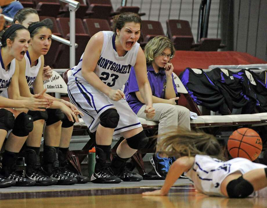 Montgomery's Rina Rraci (23) cheers on teammate DeLaney Mayberry's effort for a loose ball during the first half of the Class 4A Region 3 Final girls high school basketball game against Georgetown, Saturday, February 22, 2014, at Campbell Center in Houston. Photo: Eric Christian Smith, For The Chronicle