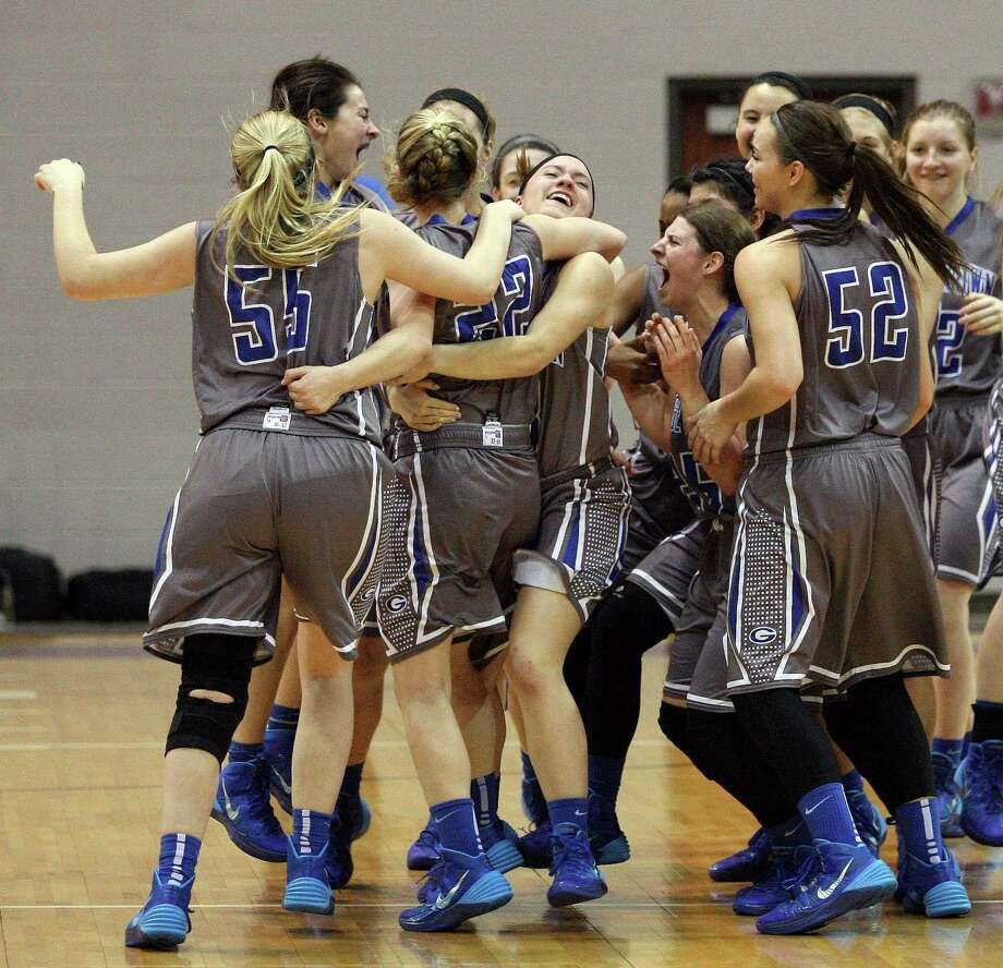 The Georgetown Lady Eagles celebrate their 53-43 victory over Montgomery in the Class 4A Region 3 Final girls high school basketball game, Saturday, February 22, 2014, at Campbell Center in Houston. Photo: Eric Christian Smith, For The Chronicle