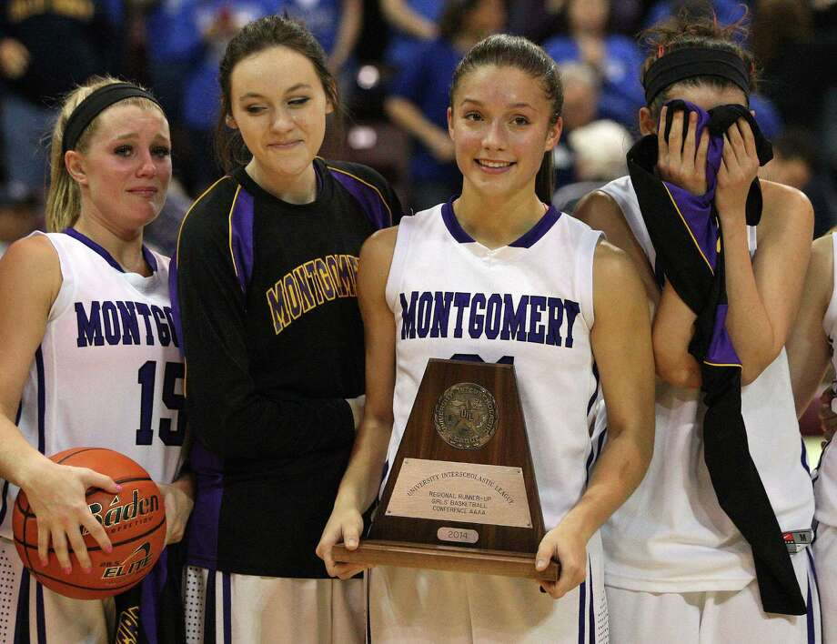 Montgomery's DeLaney Mayberry, second from right, holds the runner-up trophy with teammates following the Bears' 53-43 loss to Georgetown in the Class 4A Region 3 Final girls high school basketball game, Saturday, February 22, 2014, at Campbell Center in Houston. Photo: Eric Christian Smith, For The Chronicle