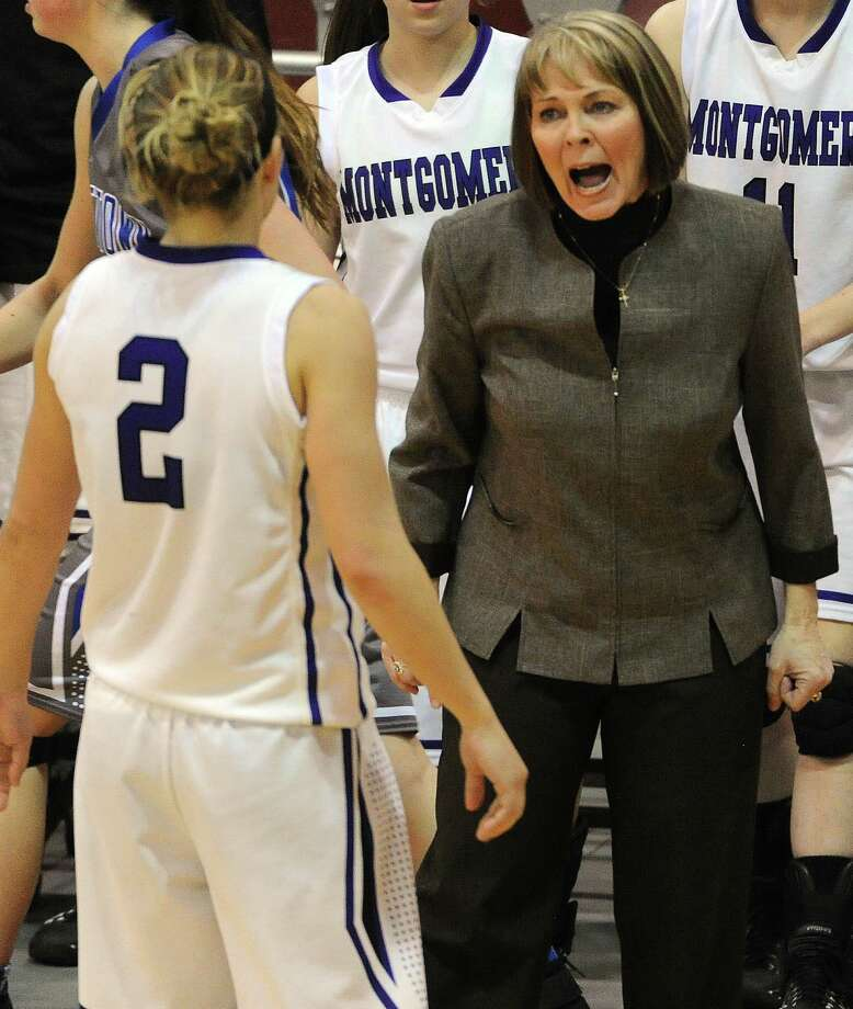 Montgomery head coach Stacey Blalock, right, yells at Malloree Schurr during a timeout during the second half of the Class 4A Region 3 Final girls high school basketball game against Georgetown, Saturday, February 22, 2014, at Campbell Center in Houston. Photo: Eric Christian Smith, For The Chronicle