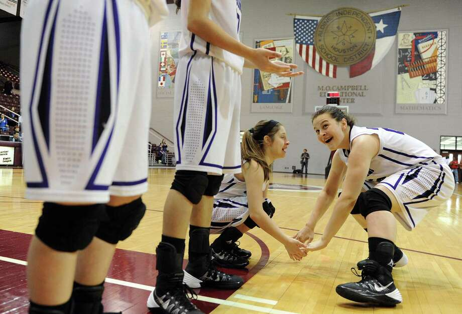 Montgomery's Rina Rraci, right, greets teammate Amber Szymczak before the Class 4A Region 3 Final girls high school basketball game against Georgetown, Saturday, February 22, 2014, at Campbell Center in Houston. Photo: Eric Christian Smith, For The Chronicle