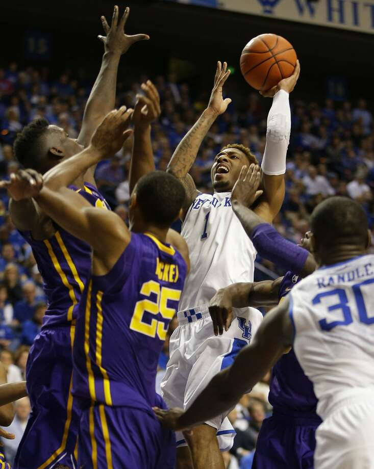 Kentucky's James Young drives the lane for a basket in overtime against LSU. Photo: Mark Cornelison, McClatchy-Tribune News Service