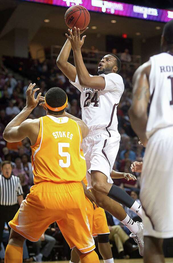 Texas A&M's Antwan Space releases a shot against Tennessee's Jarnell Stokes during the first half of an NCAA college basketball game in College Station, Texas, Saturday, Feb. 22, 2014. (AP Photo/Bryan College Station Eagle, Stuart Villanueva) Photo: Stuart Villanueva, Associated Press / Bryan College Station Eagle