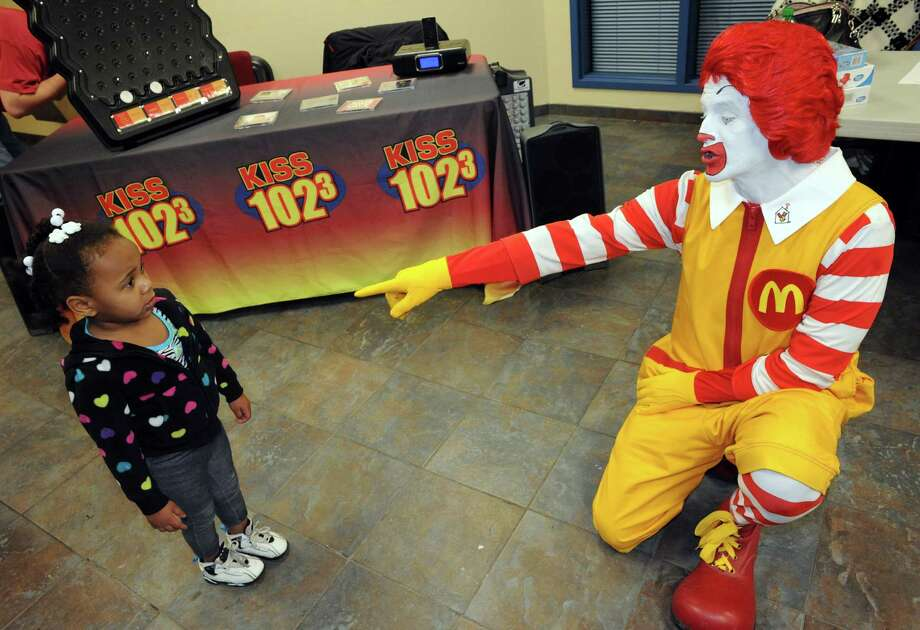 Ronald McDonald meets 2-year-old Onnavey Montes, left, during the Salvation Army School Break Bash Friday afternoon, Feb. 21, 2014, at the Salvation Army on South Ferry St. in Albany, N.Y. The event was aimed at educating children about healthy living. (Michael P. Farrell/Times Union) Photo: Michael P. Farrell / 00025776A