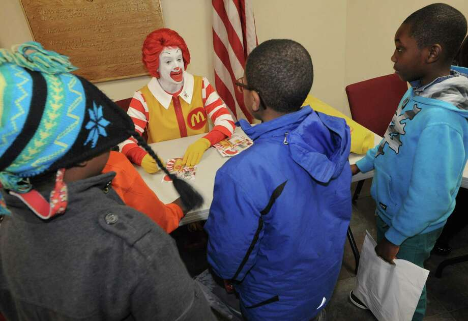 Ronald McDonald signs autograph and talks about proper dental hygiene as part of the Salvation Army School Break Bash Friday afternoon, Feb. 21, 2014, at the Salvation Army on South Ferry St. in Albany, N.Y. The event was aimed at educating children about healthy living. (Michael P. Farrell/Times Union) Photo: Michael P. Farrell / 00025776A