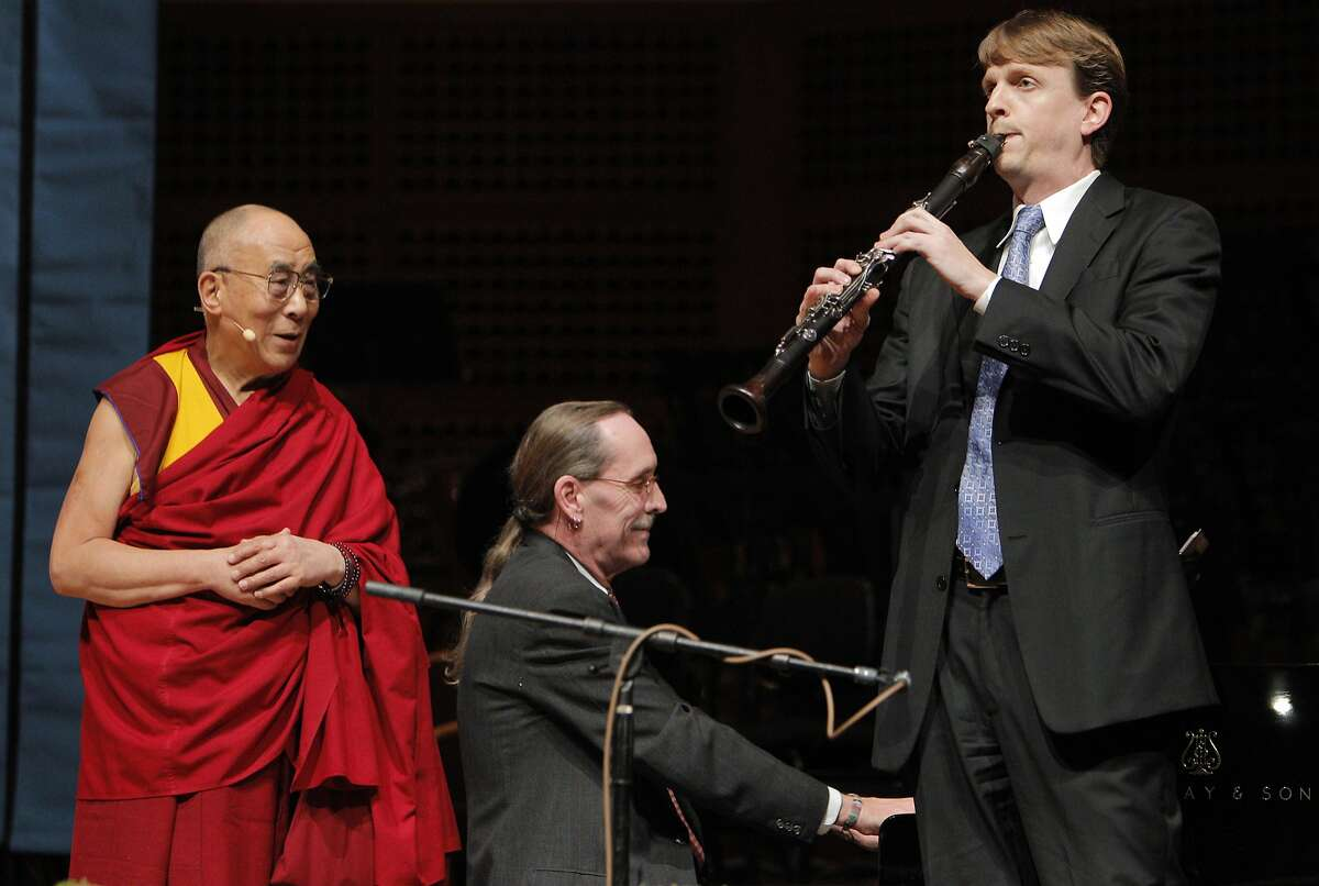 His Holiness the 14th Dalai Lama listens as pianist Robin Sutherland and clarinetist Carey Bell played as song before he spoke at Davies Symphony Hall in San Francisco, Calif., on Saturday, February 22, 2014, as part of The American Himalayan Foundation and the Blum Center for Developing Economies at UC Berkeley talk titled �