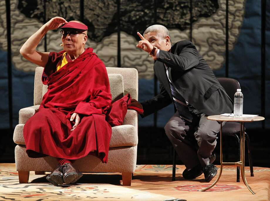 """His Holiness the 14th Dalai Lama's interpreter, Geshe Thupten Jinpa points to UC Berkeley students before His Holiness spoke at Davies Symphony Hall in San Francisco, Calif., on Saturday, February 22, 2014, as part of The American Himalayan Foundation and the Blum Center for Developing Economies at UC Berkeley talk titled """"The Nature of Mind."""" Photo: Carlos Avila Gonzalez, The Chronicle"""