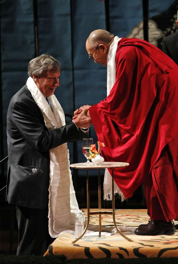 "His Holiness the 14th Dalai Lama shakes hands with Richard Blum before he spoke at Davies Symphony Hall in San Francisco, Calif., on Saturday, February 22, 2014, as part of The American Himalayan Foundation and the Blum Center for Developing Economies at UC Berkeley talk titled ""The Nature of Mind."" Photo: Carlos Avila Gonzalez, The Chronicle"