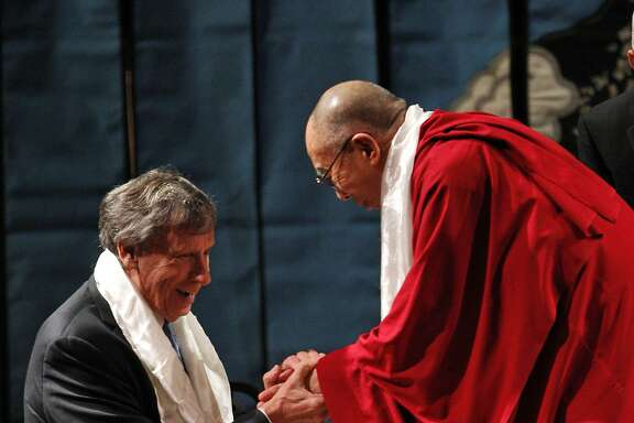 "His Holiness the 14th Dalai Lama shakes hands with Richard Blum before he spoke at Davies Symphony Hall in San Francisco, Calif., on Saturday, February 22, 2014, as part of The American Himalayan Foundation and the Blum Center for Developing Economies at UC Berkeley talk titled ""The Nature of Mind."""