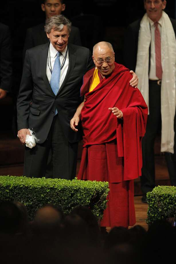 "Richard Blum, left, puts his arm around the Dalai Lama at the conclusion of His Holiness's speech at Davies Symphony Hall on Saturday. His Holiness the 14th Dalai Lama spoke at Davies Symphony Hall in San Francisco, Calif., on Saturday, February 22, 2014, as part of The American Himalayan Foundation and the Blum Center for Developing Economies at UC Berkeley talk titled ""The Nature of Mind."" Photo: Carlos Avila Gonzalez, The Chronicle"