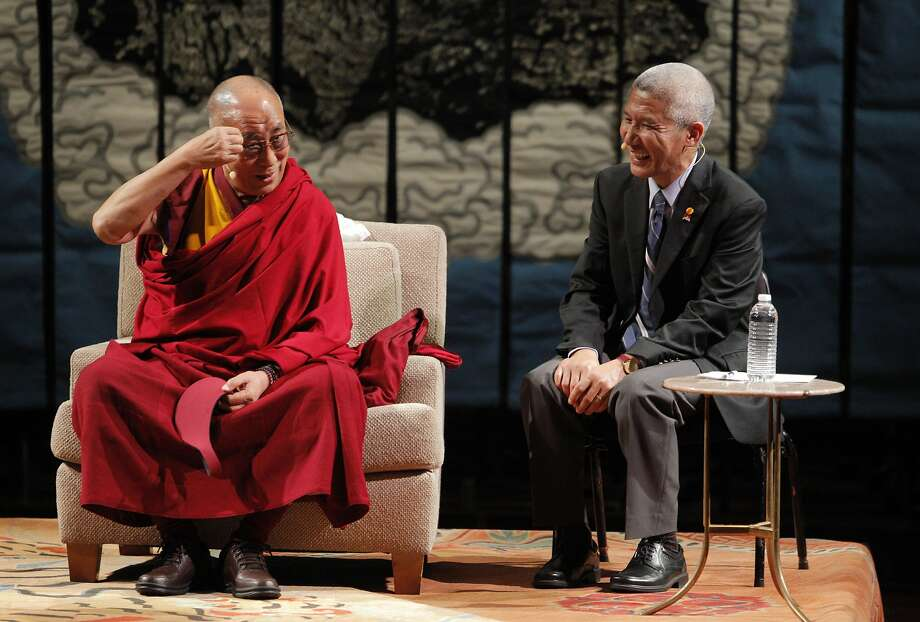 "The Dalai Lama jokes on stage to the crowd about growing older and having his eyebrows grow long with his interpreter Geshe Thupten Jinpa on Saturday. His Holiness the 14th Dalai Lama spoke at Davies Symphony Hall in San Francisco, Calif., on Saturday, February 22, 2014, as part of The American Himalayan Foundation and the Blum Center for Developing Economies at UC Berkeley talk titled ""The Nature of Mind."" Photo: Carlos Avila Gonzalez, The Chronicle"