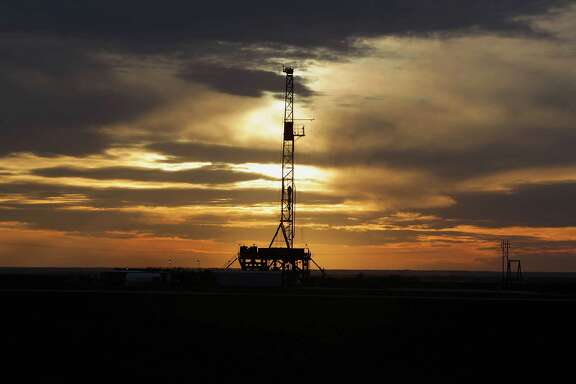A drilling rig in Howard county, Texas as the sun sets Monday, Feb. 17, 2014, in Big Spring. ( James Nielsen / Houston Chronicle )