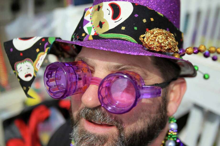 Matthew Perry wears his beer goggles during The Mystic Krewe of Aquarius 29th Annual Mardi Gras Parade as it travels along Seawall Blvd. on Saturday, Feb. 22, 2014, in Galveston. Photo: Mayra Beltran, Houston Chronicle / © 2014 Houston Chronicle