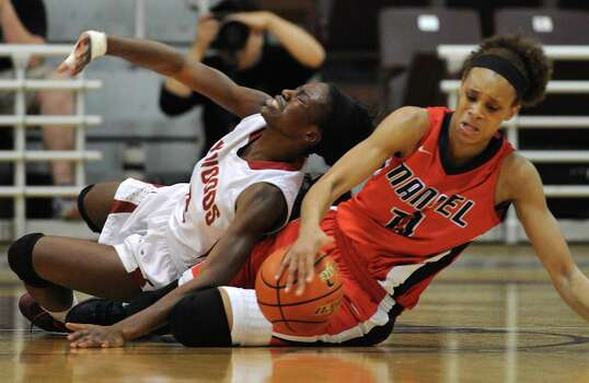 Manvel's Brianna Turner, right, fights for a loose ball with Cy-Woods; Gbemi Orundami during the second half of the Class 5A Region 3 Final girls high school basketball game, Saturday, February 22, 2014, at Campbell Center in Houston. Photo: Eric Christian Smith, For The Chronicle