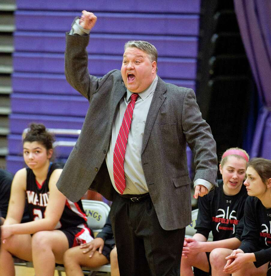 Fairfield Warde coach David Danko yells to his team during Saturday's FCIAC girls basketball quarterfinal game at Westhill High School on February 22, 2014. Photo: Lindsay Perry / Stamford Advocate