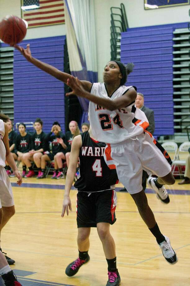 Stamford's Tiana England puts up a shot during Saturday's FCIAC girls basketball quarterfinal game against Fairfield Warde at Westhill High School on February 22, 2014. Photo: Lindsay Perry / Stamford Advocate