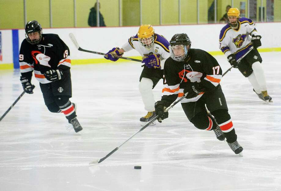 Stamford's Andrew Kydes controls the puck during Friday's hockey game against Westhill at Terry Connors Rink in Stamford, Conn., on February 21, 2014. Photo: Lindsay Perry / Stamford Advocate