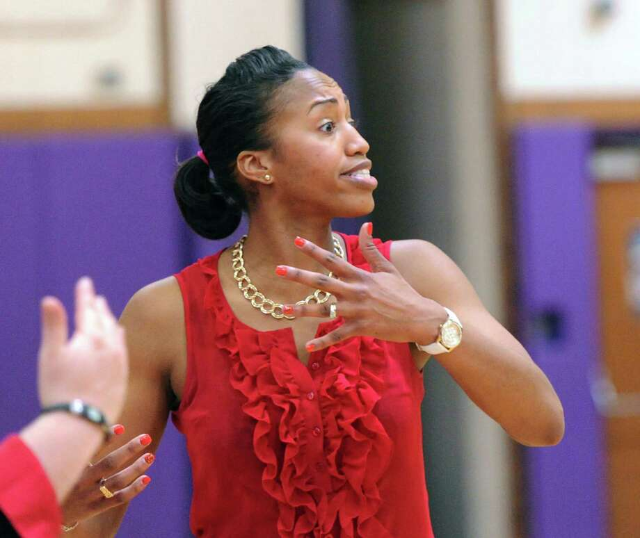 Greenwich High School girls basketball coach Chrys Hernandez reacts during the FCIAC girls basketball quarterfinal between Westhill High School and Greenwich High School at Westhill in Stamford, Saturday, Feb. 22, 2014. Greenwich defeated Westhill, 55-51. Photo: Bob Luckey / Greenwich Time