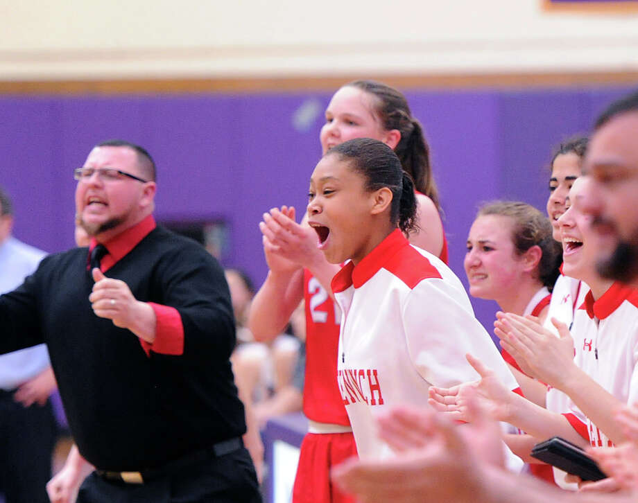 The Greenwich bench reacts to a basket during the FCIAC girls basketball quarterfinal between Westhill High School and Greenwich High School at Westhill in Stamford, Saturday, Feb. 22, 2014. Greenwich defeated Westhill, 55-51. Photo: Bob Luckey / Greenwich Time