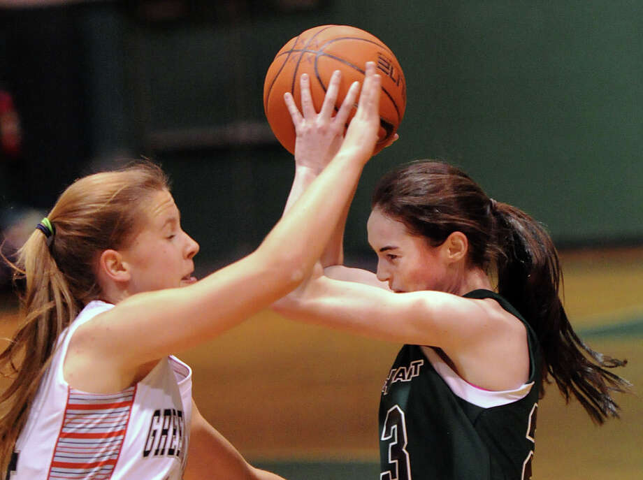 At left, Campbell Goldsmith (#14) of Greens Farms Academy defends Convent of the Sacred Heart's Colleen O'Neill, right, during the FAA girls high school basketball quarterfinals between Convent of the Sacred Heart and Greens Farms Academy at Convent in Greenwich, Thursday, Feb. 20, 2014. Photo: Bob Luckey / Greenwich Time