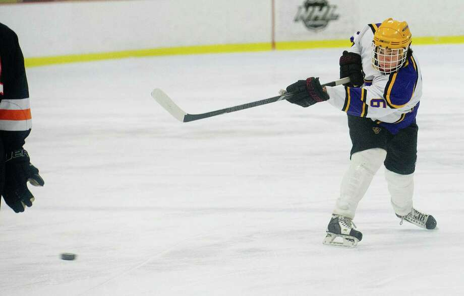 Westhill's Glen Brown takes a shot during Friday's hockey game against Stamford High School at Terry Connors Rink in Stamford, Conn., on February 21, 2014. Photo: Lindsay Perry / Stamford Advocate
