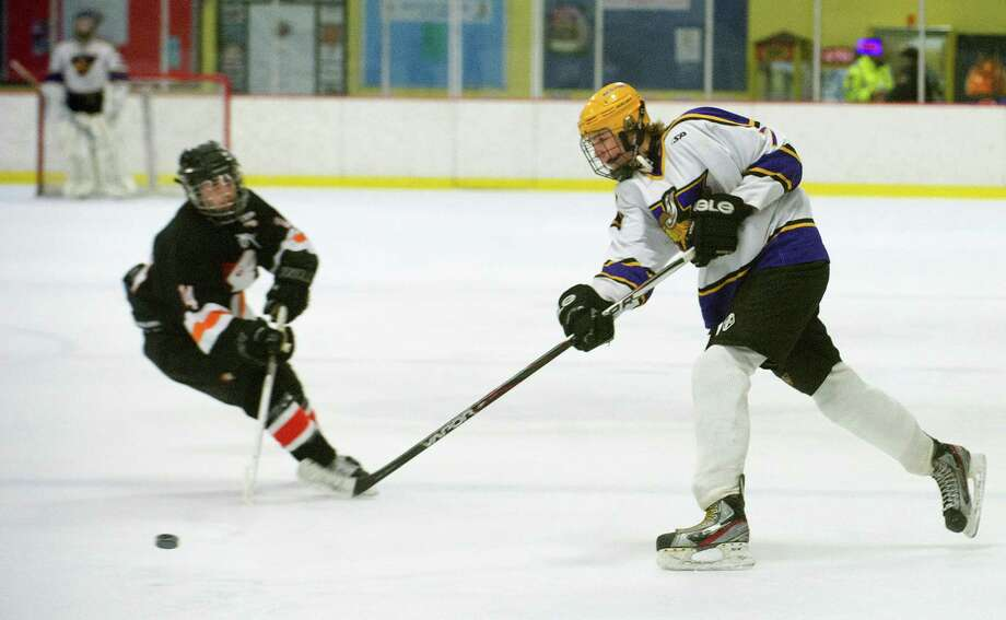 Westhill's Gunnar Eriksen controls the puck during Friday's hockey game against Stamford High School at Terry Connors Rink in Stamford, Conn., on February 21, 2014. Photo: Lindsay Perry / Stamford Advocate