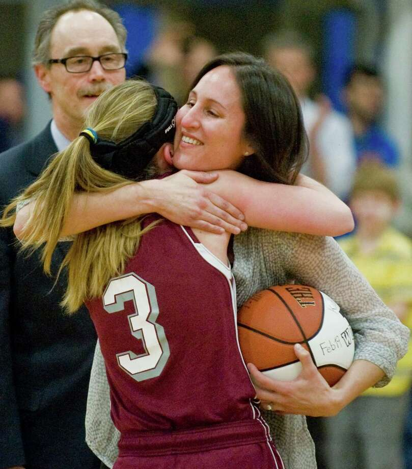Wooster School's Kate MacNutt, after scoring her 1000th point, receives a hug from alum Mckenzie Corby Howarth, the only other Wooster School student to score 1000 points. Thursday, Feb. 20, 2014 Photo: Scott Mullin / The News-Times Freelance