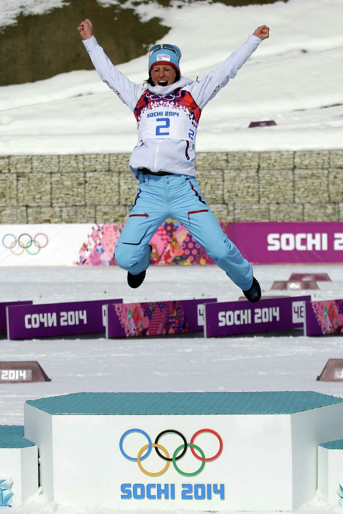 Norway's Marit Bjoergen celebrates on the podium after winning the gold medal in the women's 30K cross-country race at the 2014 Winter Olympics, Saturday, Feb. 22, 2014, in Krasnaya Polyana, Russia. (AP Photo/Gregorio Borgia) ORG XMIT: OLYCC326