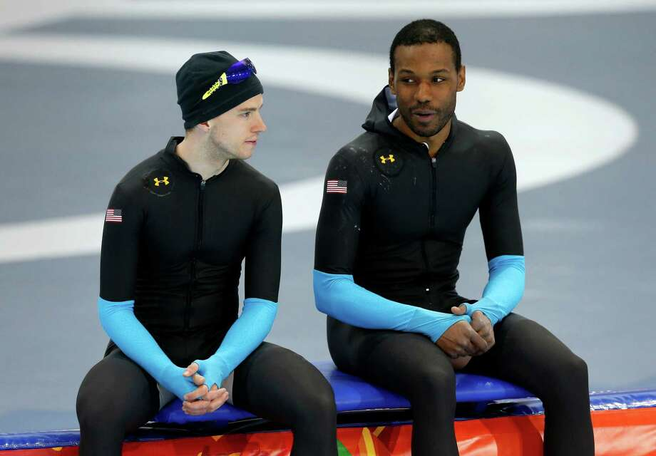 United States' Patrick Meek, left, and Shani Davis chat during a speedskating training session at the 2014 Winter Olympics in Sochi, Russia, Thursday, Feb. 20, 2014. (AP Photo/Patrick Semansky) ORG XMIT: OLYSS106 Photo: Patrick Semansky / AP