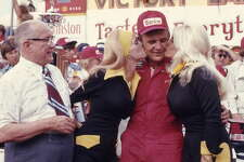 DAYTONA BEACH, FL - FEBRUARY 16:  Driver Benny Parsons celebrates with two kisses in Victory Lane after winning the Daytona 500 on February 16, 1975 at the Daytona International Speedway in Daytona Beach, Florida.