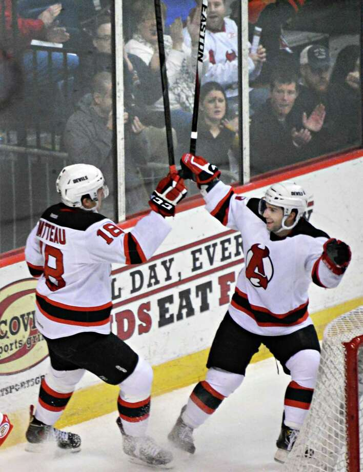Albany Devils' #18 Stefan Matteau, left, is congratulated by team mate #9 Joe Whitney after Matteau's goal during Saturday's game against  the Norfolk Admirals at the Times Union Center Feb. 22, 2014, in Albany, NY. (John Carl D'Annibale / Times Union) Photo: John Carl D'Annibale / 00025826A