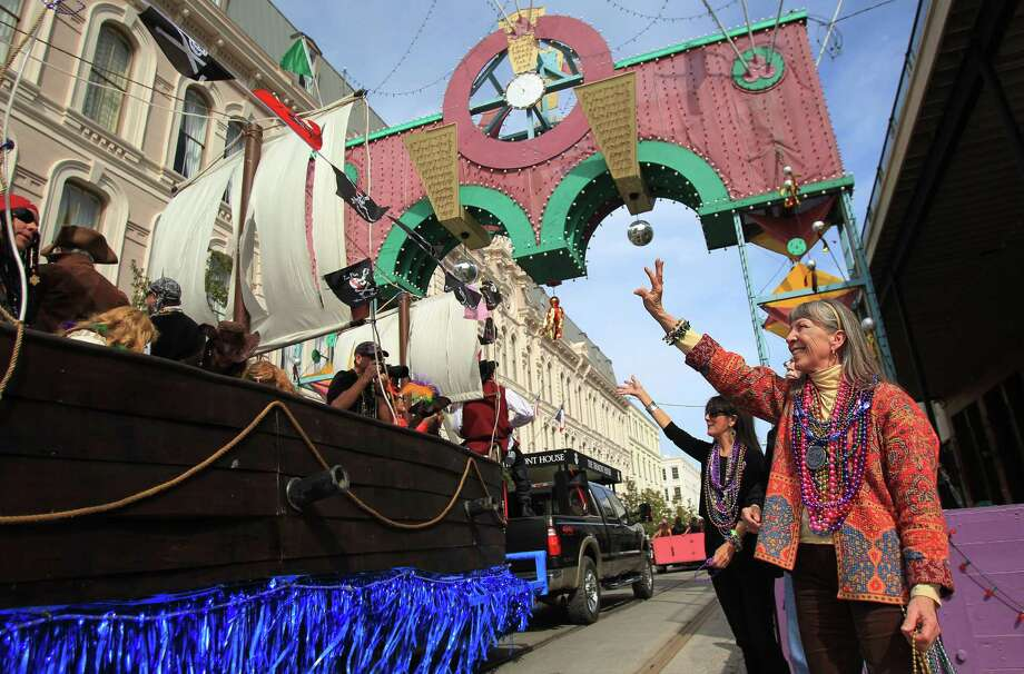 Kit Basye weaves during The Mystic Krewe of Aquarius 29th Annual Mardi Gras Parade as it reaches The Strand on Saturday, Feb. 22, 2014, in Galveston. Photo: Mayra Beltran, Houston Chronicle / © 2014 Houston Chronicle
